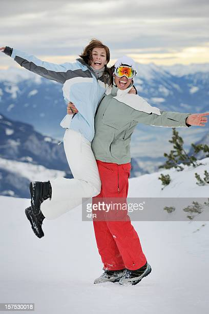 snowboarder couple having fun in the snow (xxxl) - ski pants stock pictures, royalty-free photos & images