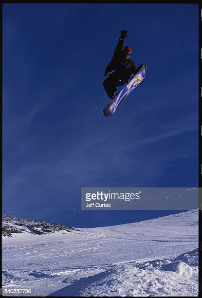 Snowboarder Dave Downing Performing Tail Grab