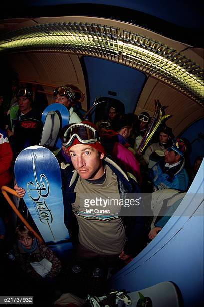 Snowboarder Dave Downing Standing in Subway Car