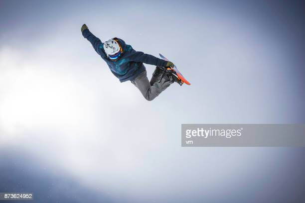 Snowboarder doing a method grab