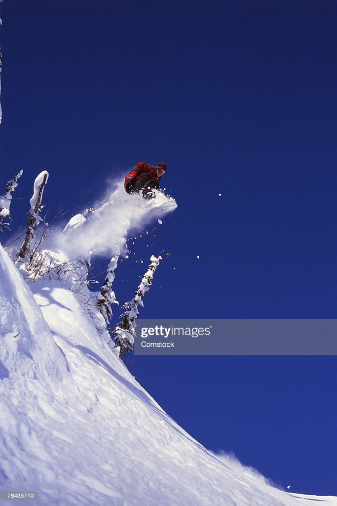 Snowboarder doing an indy grab in British Columbia , Canada : Stockfoto