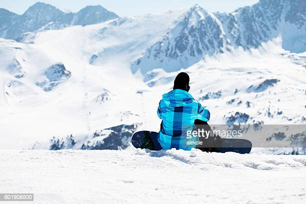 Snowboarder enjoying the nature in mountains