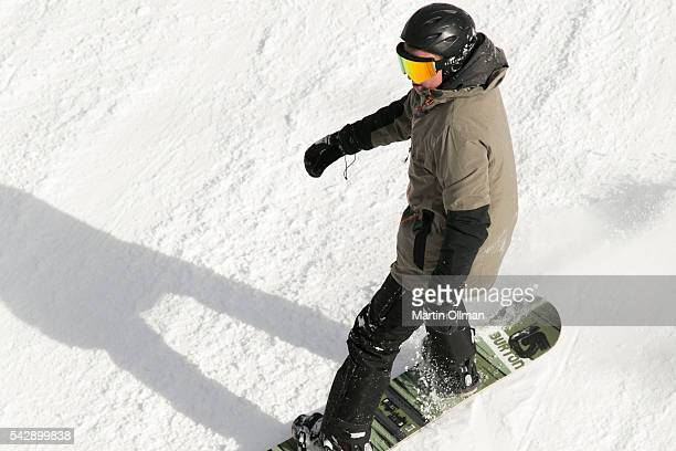 A snowboarder enjoys the fresh snowfall on the opening weekend of the season on June 25 2016 in Thredbo Village Australia Snow has been forecast...