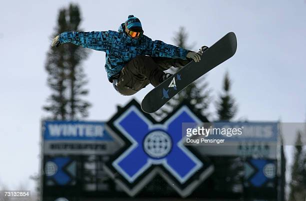 A snowboarder flies high above the superpipe during an open session at the ESPN Winter X Games 11 on January 27 2007 in Aspen Colorado