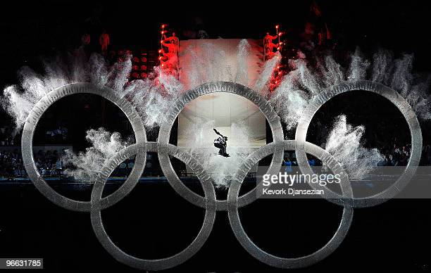 Snowboarder flies thru the Olympic Rings during the Opening Ceremony of the 2010 Vancouver Winter Olympics at BC Place on February 12, 2010 in...