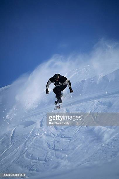 snowboarder going down slope, chugach mountains, alaska, usa, low angle view - chugach state park stock pictures, royalty-free photos & images
