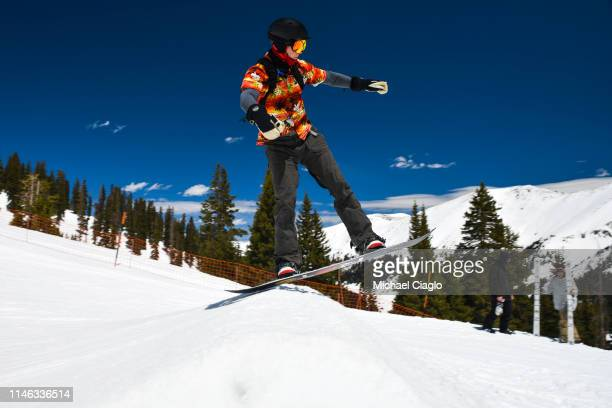 A snowboarder hits a jump at the Treeline Terrain Park at Arapahoe Basin Ski Area on May 25 2019 in Dillon Colorado Even as temperatures are expected...