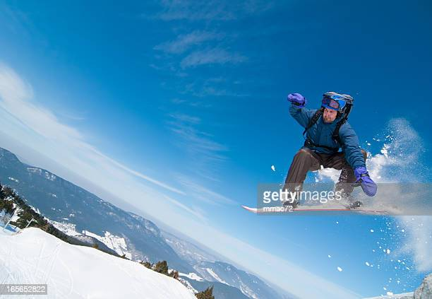 Snowboarder in Acrobatic Jump