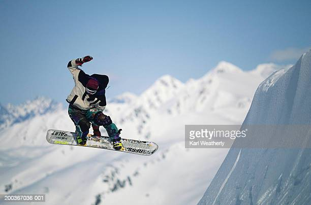 snowboarder in air, chugach mountains, alaska, usa - snowboarding stock pictures, royalty-free photos & images