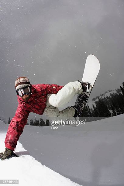 Snowboarder in Mid-air at Edge of Halfpipe
