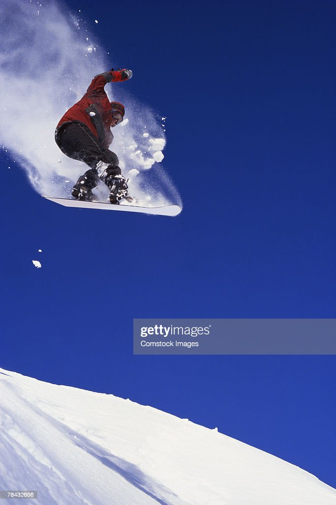 Snowboarder in mid-air : Stockfoto