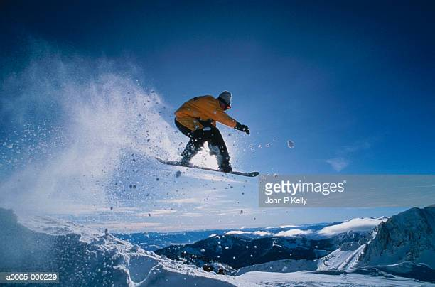 snowboarder in motion - snowboarding stock pictures, royalty-free photos & images