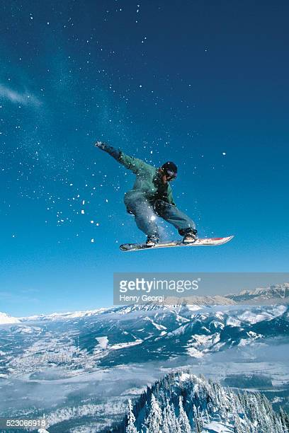 snowboarder in the air - freestyle skiing stock pictures, royalty-free photos & images