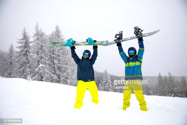 snowboarder in the alps - group of friends having fun in a winter vacation - winter sport stock pictures, royalty-free photos & images