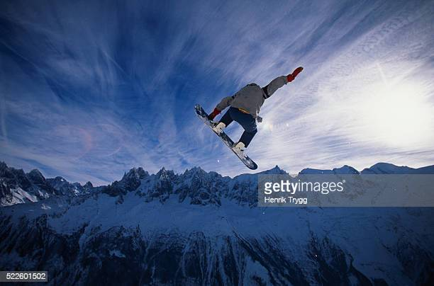 Snowboarder Jumping on Brevant in Chamonix