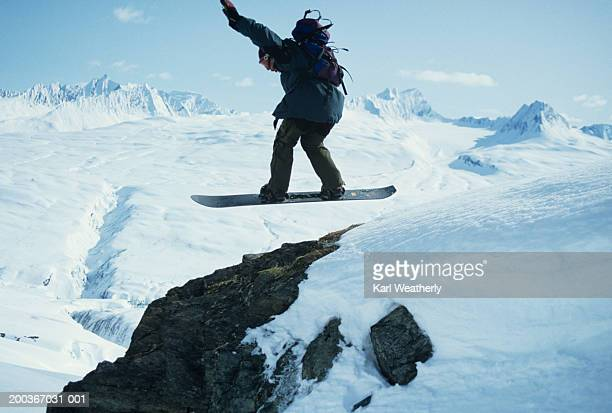 snowboarder jumping over rocks, chugach mountains, alaska, usa - chugach state park stock pictures, royalty-free photos & images