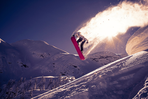 Snowboarder jumps into the sun - gettyimageskorea