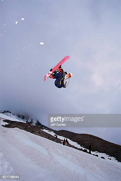 Snowboarder Leaping off Tube