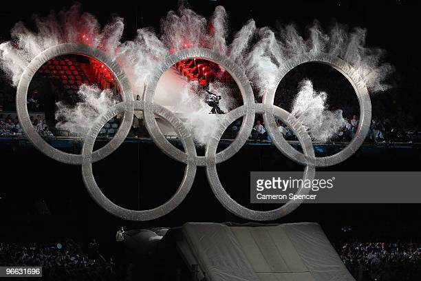 Snowboarder leaps through the Olympic Rings to begin the Opening Ceremony of the 2010 Vancouver Winter Olympics at BC Place on February 12, 2010 in...
