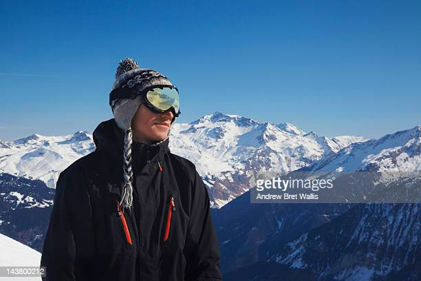 Snowboarder looking out over mountains