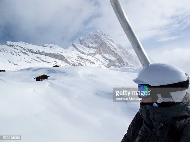 Snowboarder looking over snowy mountains