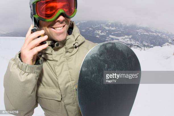 A Snowboarder Makes a Call from the Ski Slopes.