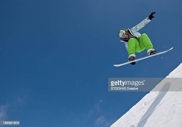 Snowboarder midair in halfpipe