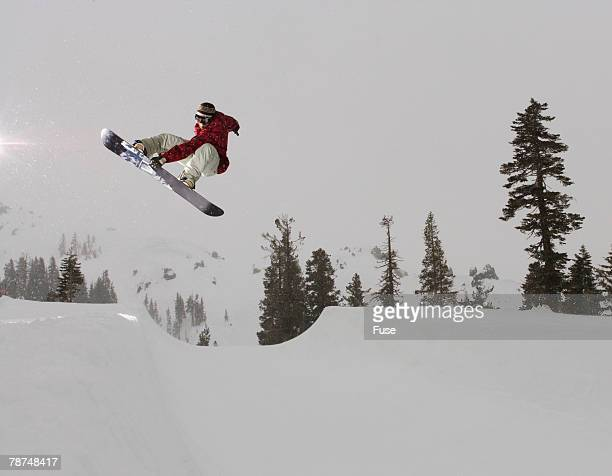 Snowboarder Mid-air in Halfpipe