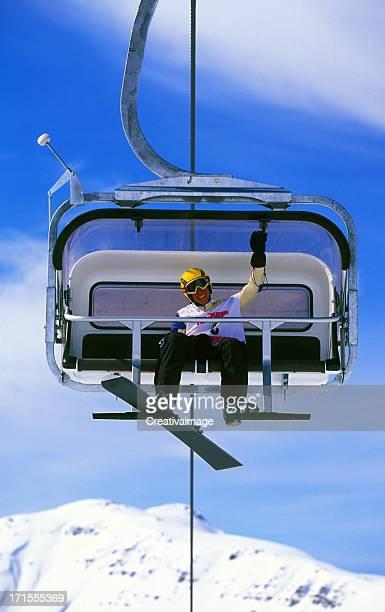 snowboarder auf dem Sessellift