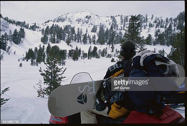 Snowboarder on Snowmobile