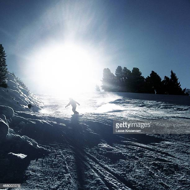 Snowboarder on the slope in the Alps