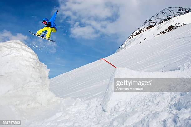 A snowboarder performing a freestyle trick