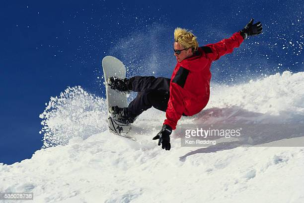 snowboarder performing heelside turn - bleached hair stock pictures, royalty-free photos & images
