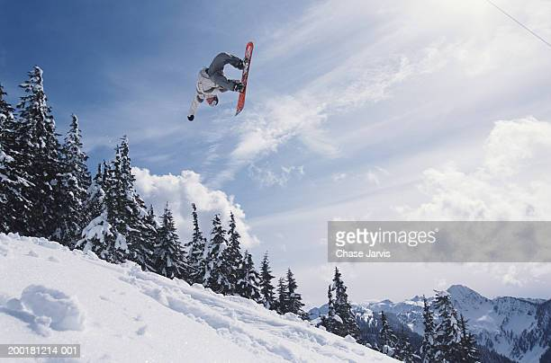 Snowboarder performing jump, low angle view
