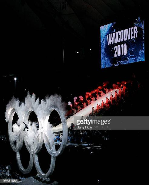 Snowboarder performs a trick through the Olympic rings during the Opening Ceremony of the 2010 Vancouver Winter Olympics at BC Place on February 12,...