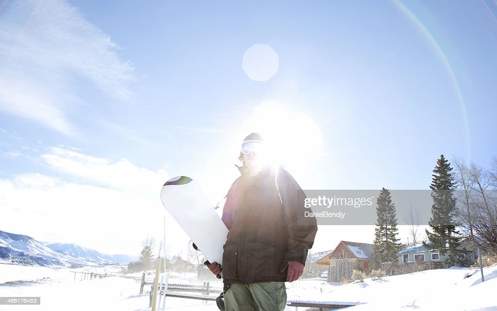 A snowboarder on the slop in Aspen, Colorado in the morning.