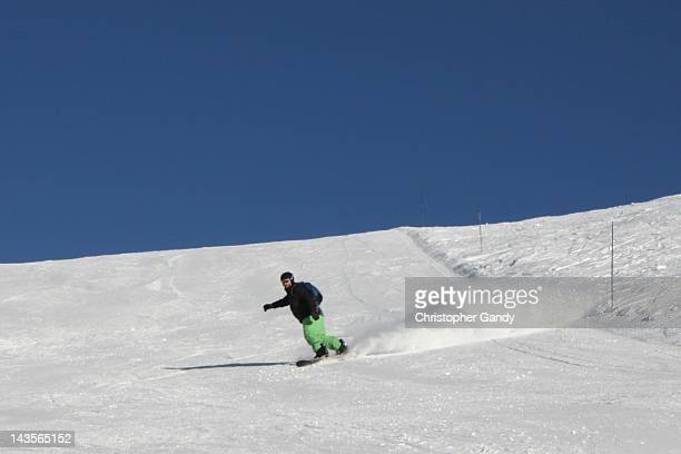 snowboarder racing down - la plagne stock photos and pictures