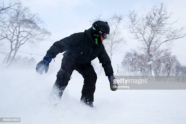 A snowboarder rides down a slope at the Niseko Hanazono resort operated by Nihon Harmony Resorts KK in Kutchan Hokkaido Japan on Sunday Feb 15 2015...