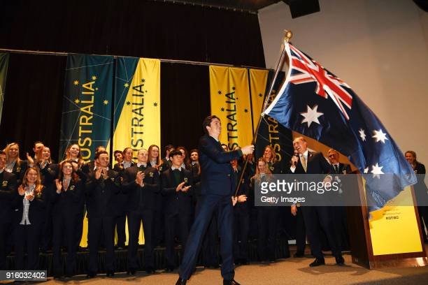 Snowboarder Scotty James of Australia waves the Australian flag after being named Team Australia's flag bearer for the Opening Ceremony of the...