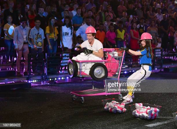 Snowboarder Shaun White and figure skater Maia Shibutani participate in a challange during the Nickelodeon Kids' Choice Sports 2018 at Barker Hangar...
