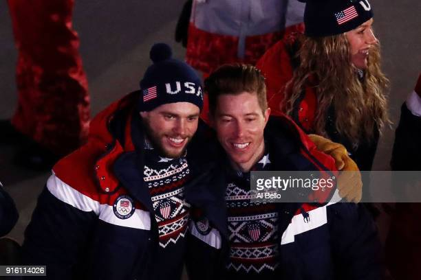 Snowboarder Shaun White and Freestyle skiier Gus Kenworthy of The United States and teammates enter the stadiumduring the Opening Ceremony of the...