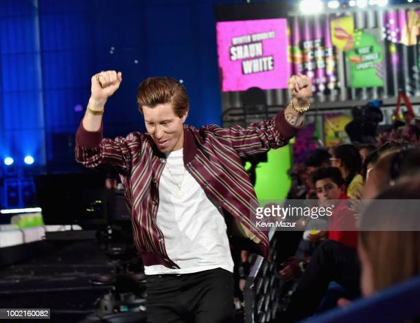 Snowboarder Shaun White appears onstage during the Nickelodeon Kids' Choice Sports 2018 at Barker Hangar on July 19 2018 in Santa Monica California