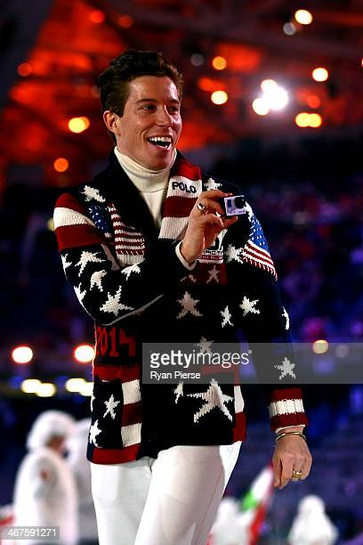 Snowboarder Shaun White enters the stadium with the United States Olympic team during the Opening Ceremony of the Sochi 2014 Winter Olympics at Fisht...