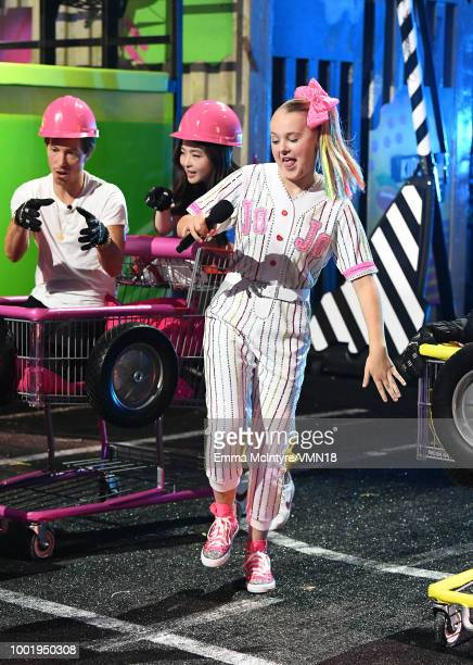 Snowboarder Shaun White figure skater Maia Shibutani and JoJo Siwa participate in a challange during the Nickelodeon Kids' Choice Sports 2018 at...