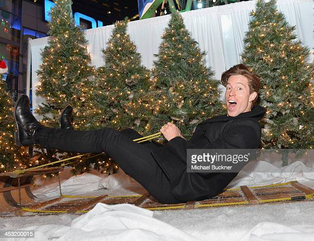 Snowboarder Shaun White poses on a sled during the BestSnowdayEver With Target And Shaun White at LA Live on December 2 2013 in Los Angeles California