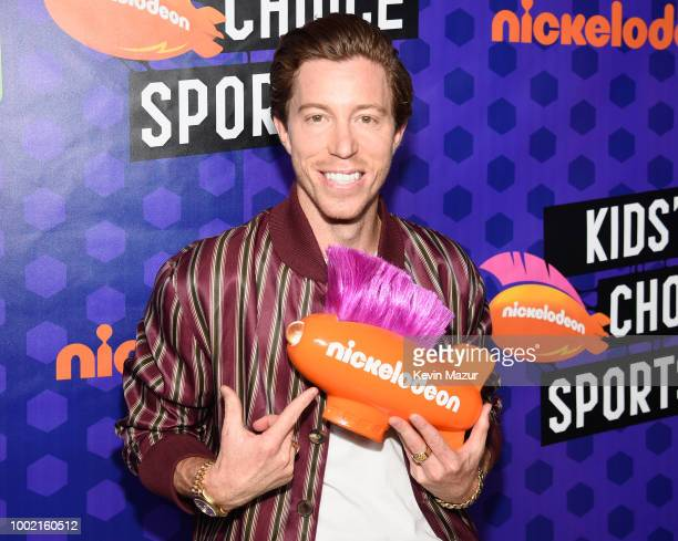 Snowboarder Shaun White poses with his award backstage at the Nickelodeon Kids' Choice Sports 2018 at Barker Hangar on July 19 2018 in Santa Monica...