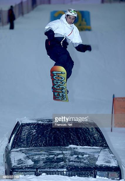 A snowboarder takes part in a special themed 'Freestyle Night Goes Mutant' event to promote 'X Men Days Of Future Past' at Ski Dubai on April 24 2014...