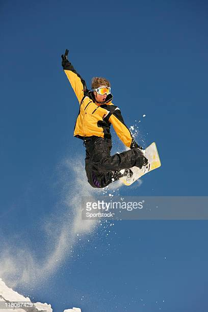 snowboarder taking a jump - golden goggles stock pictures, royalty-free photos & images