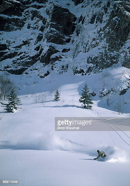 Snowboarder turning in powder snow