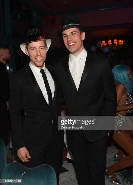 Snowboarder/musician Shaun White and actor Tanner Novlan attend Mayfair Supper Club during its debut on New Years Eve at Bellagio Las Vegas on...